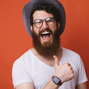 man smiling big and giving thumbs up for teeth whitening service