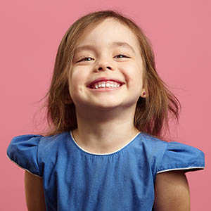 child smiling for pediatric dentistry services